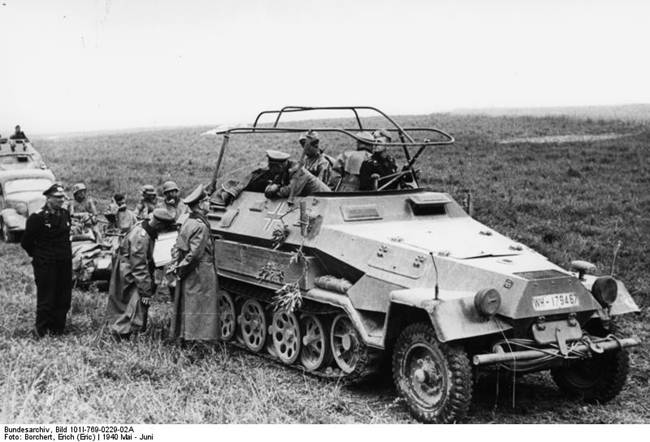 German General Heinz Guderian (in SdKfz. 251/3 halftrack vehicle) speaking with General Adolf Kuntzen of 8th Panzer Division, France, May 1940