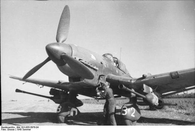 German Ju 87 Stuka dive bomber at rest, Russia, summer 1943; mechanic Hans-Ulrich Rudel was using a hand crank to start the engine; note 3.7cm FlaK 18 cannons installed under wings