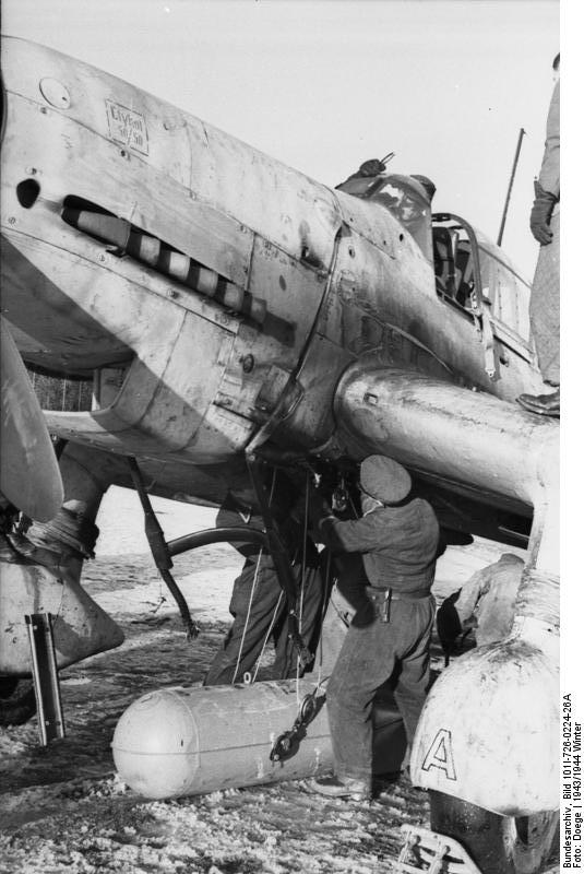 German crew working on a Ju 87 Stuka aircraft in the field, Russia, winter of 1943-1944
